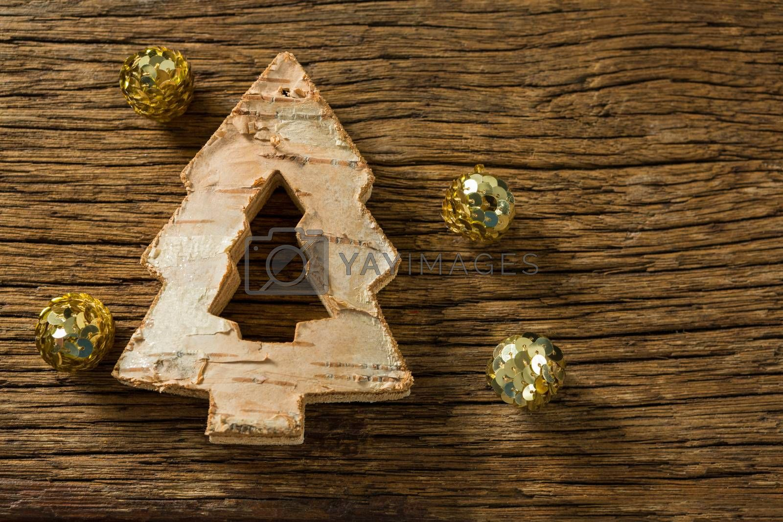 Close up of Christmas tree decoration with golden balls by Wavebreakmedia