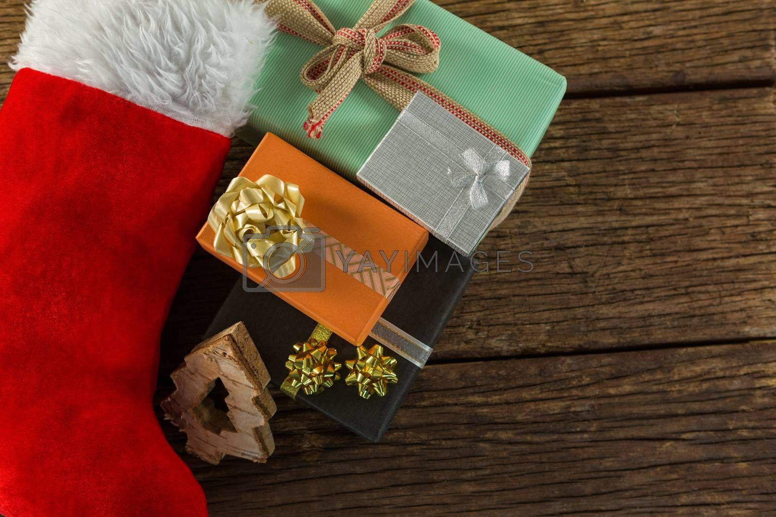 Overhead view of Christmas presents with stocking by Wavebreakmedia