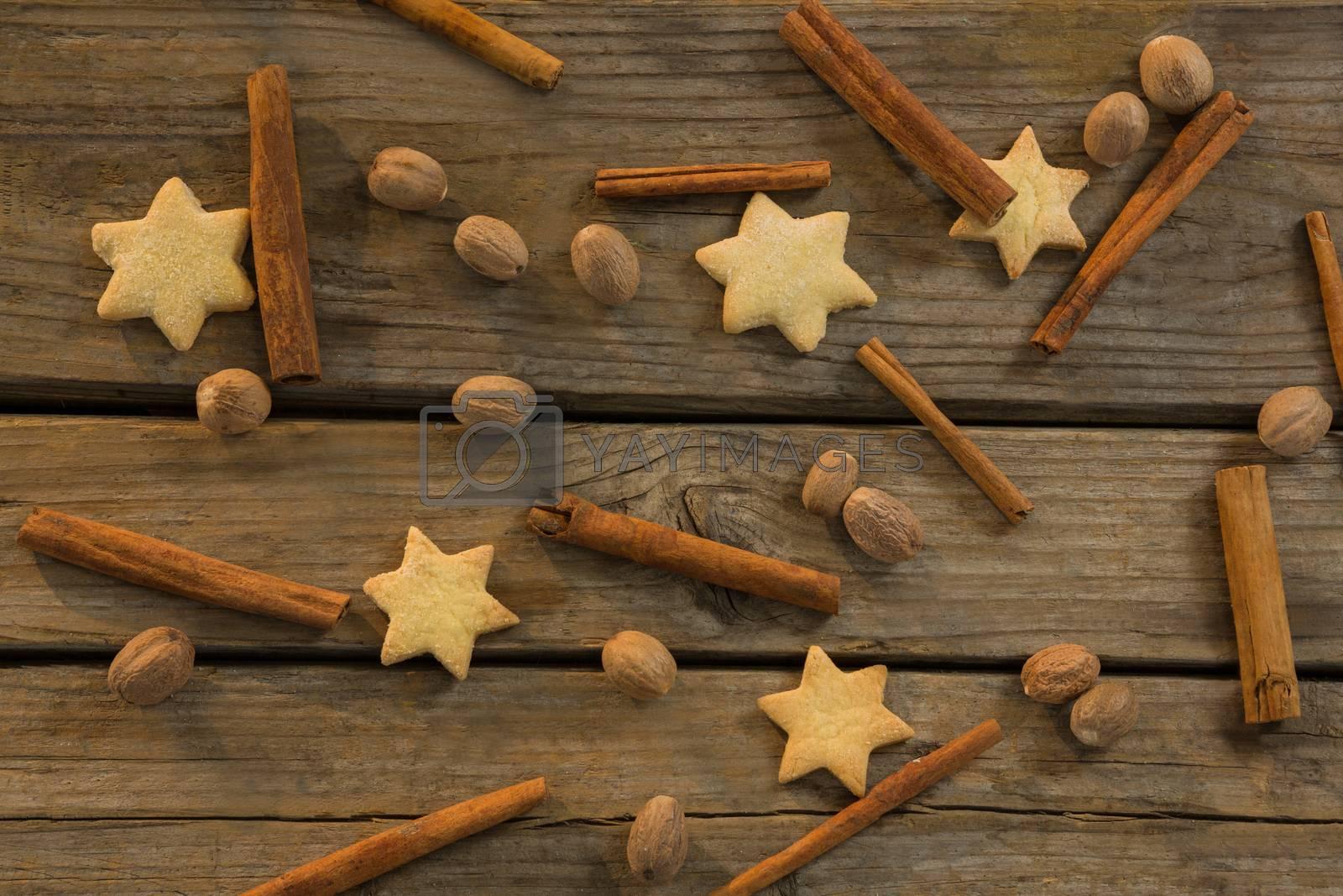 Star shape cookies and cinnamon sticks with walnuts by Wavebreakmedia