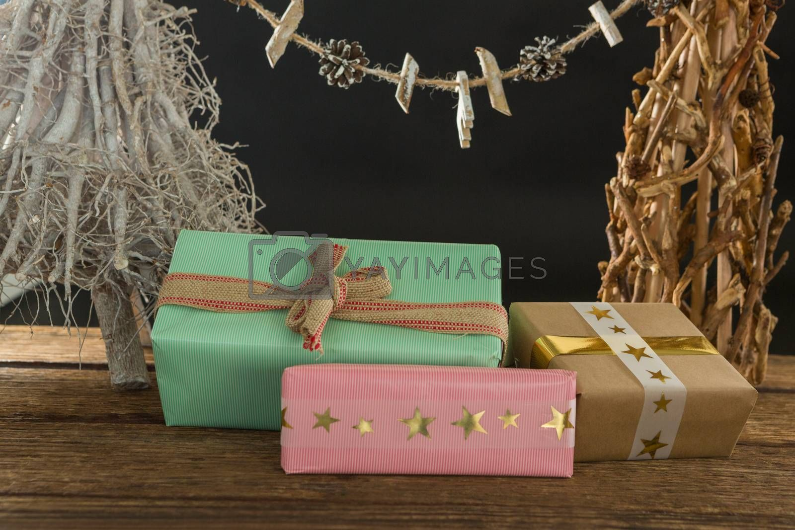Close up of gift boxes with Christmas decoration on table by Wavebreakmedia