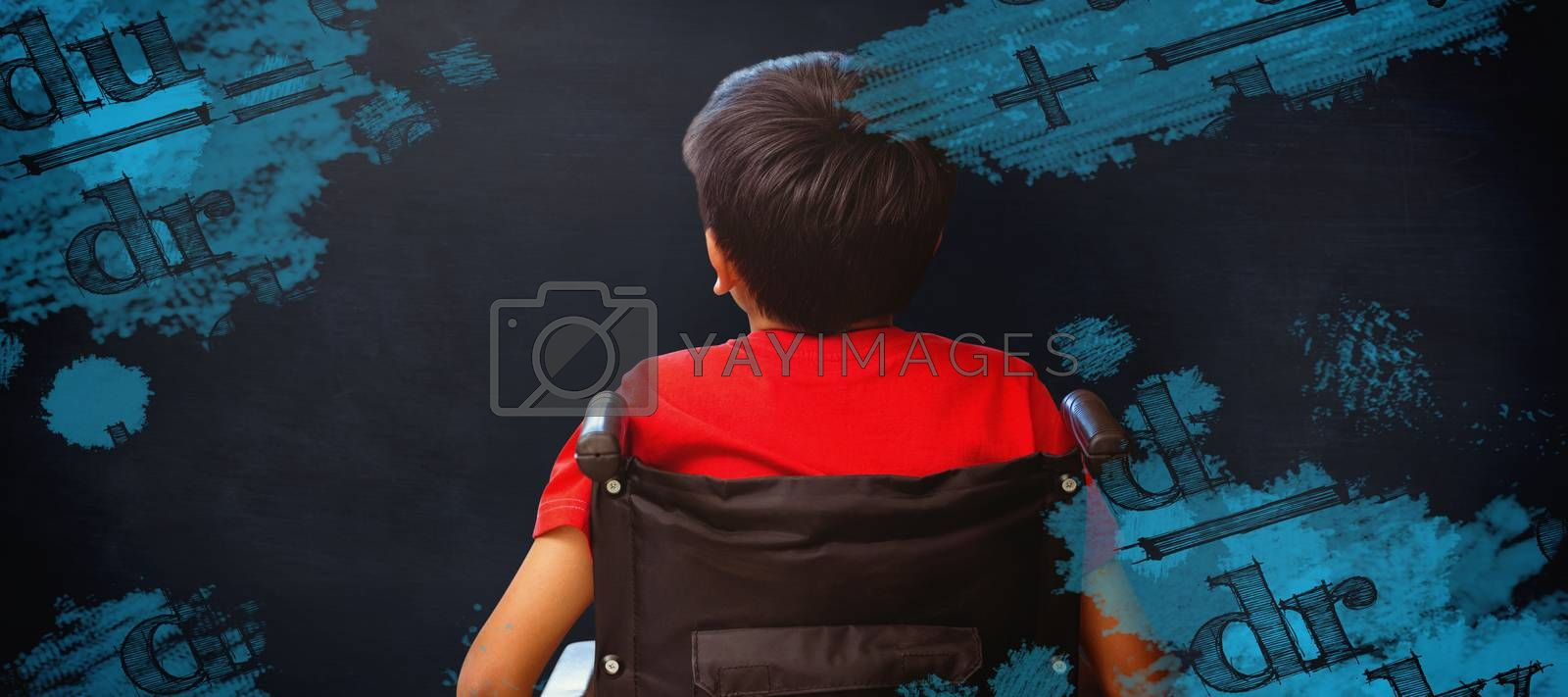 Composite image of rear view of boy sitting in wheelchair by Wavebreakmedia