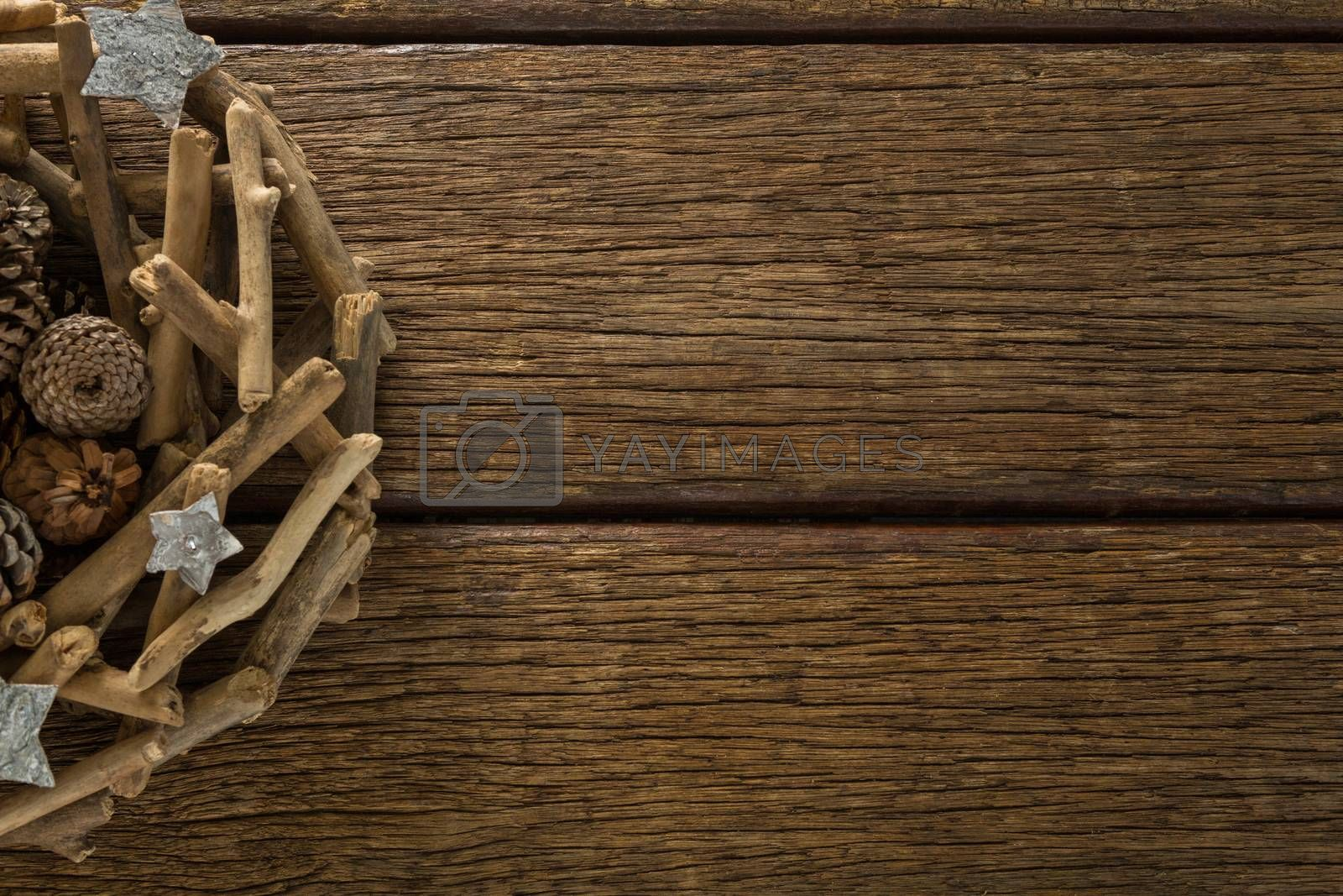 Christmas decorations on wooden table by Wavebreakmedia