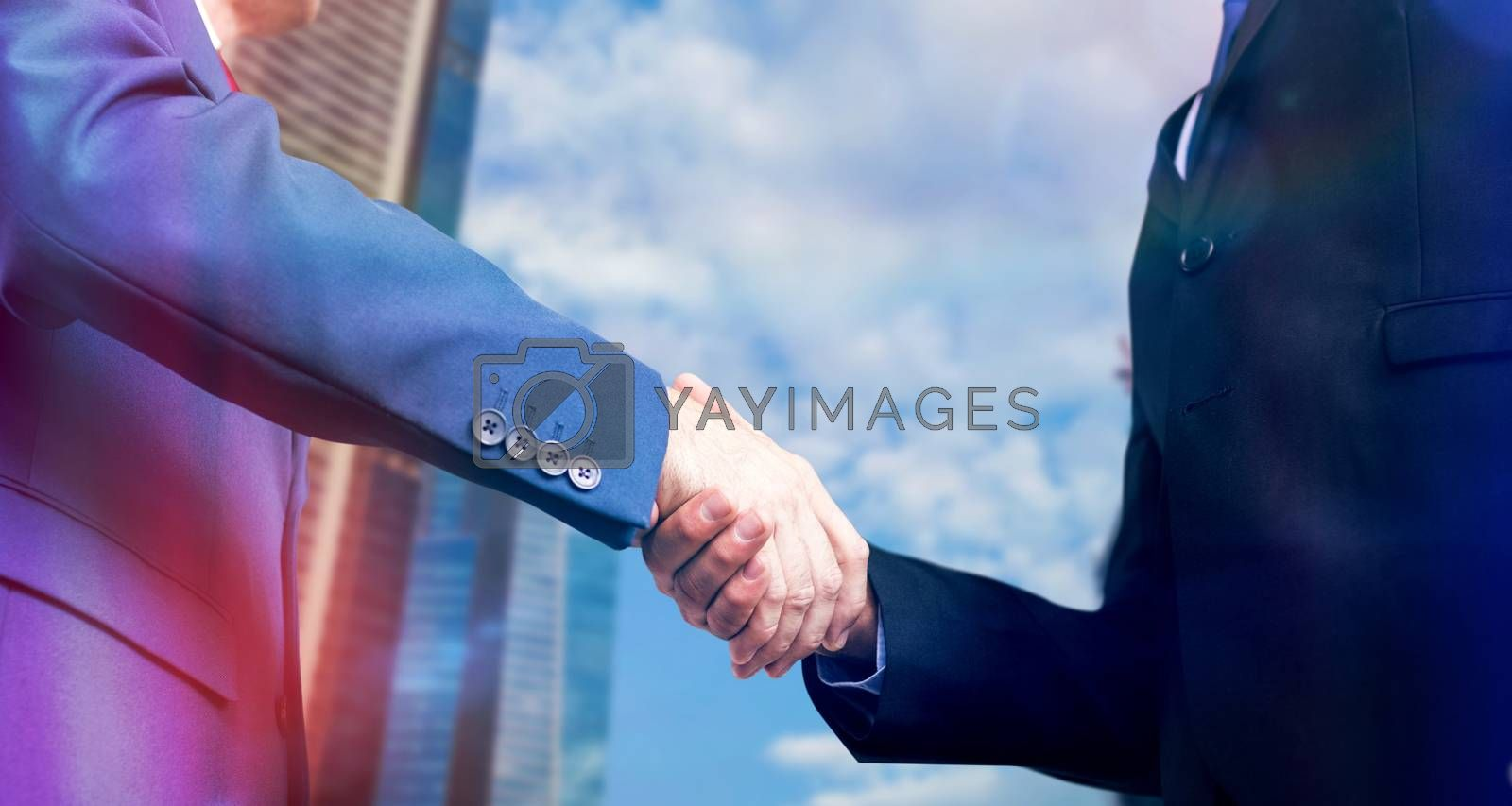 Composite image of businessman shaking hands by Wavebreakmedia