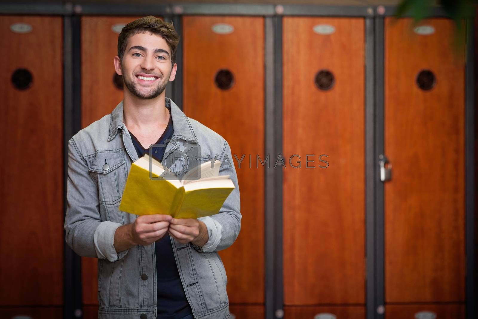 Composite image of student smiling at camera in library by Wavebreakmedia