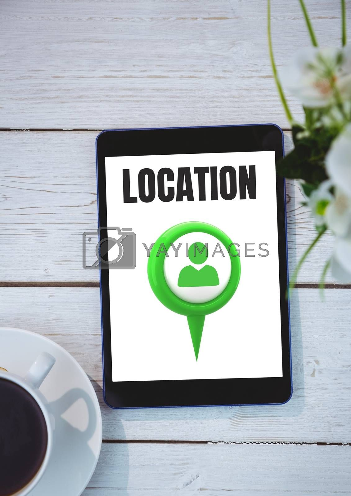 Location marker on phone on table by Wavebreakmedia