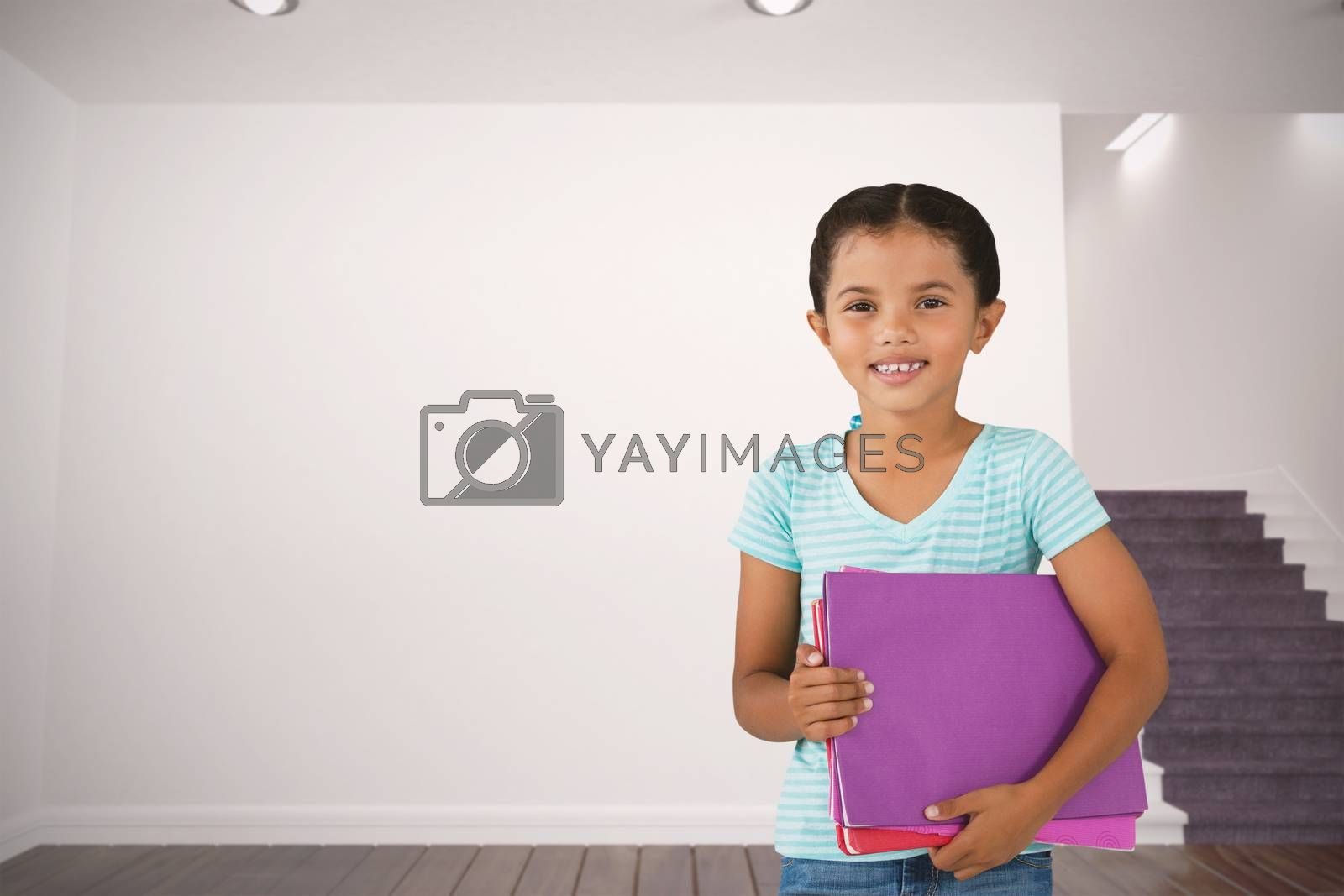 Composite image of portrait of smiling girl holding files by Wavebreakmedia