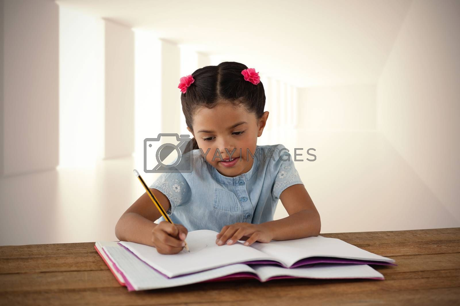 Composite image of girl writing in book at desk by Wavebreakmedia