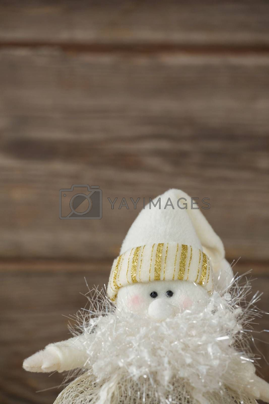 Stuff white snowman made up of cotton and fur by Wavebreakmedia