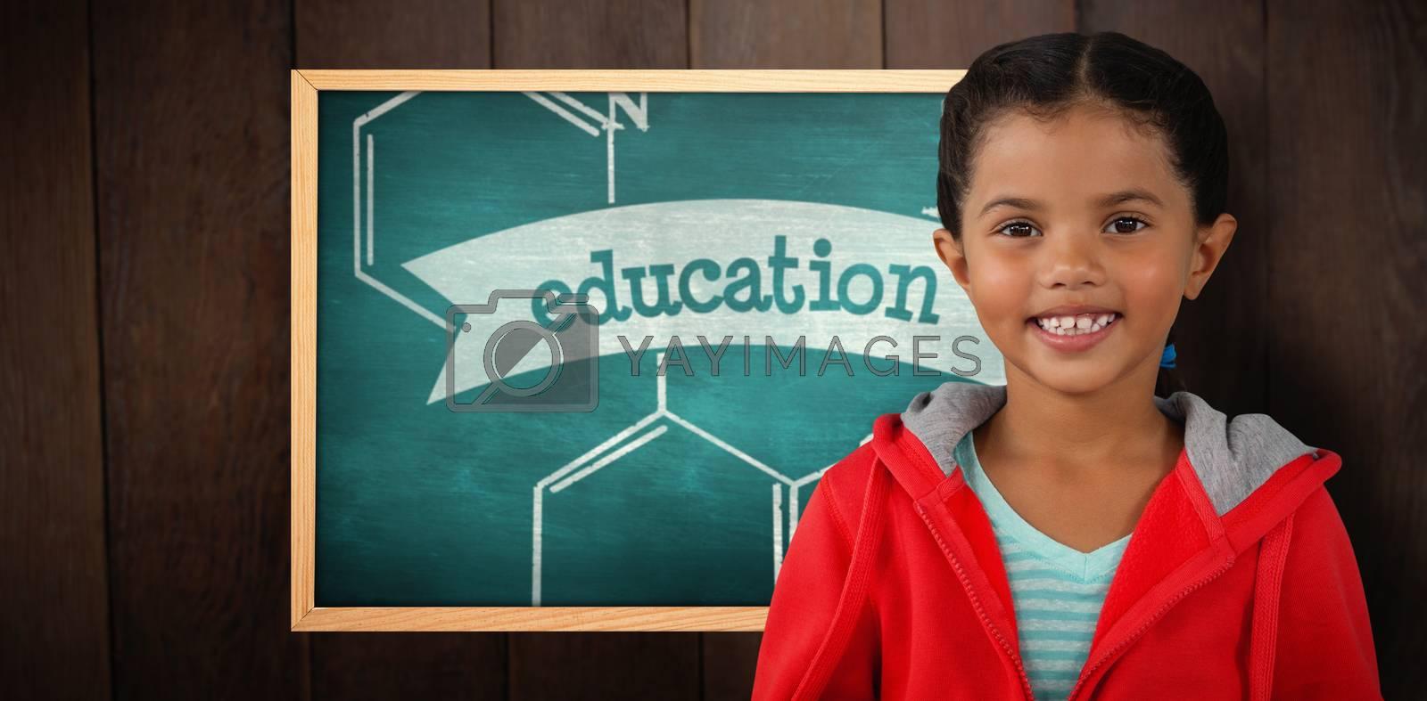 Portrait of smiling girl holding digital tablet against education against green chalkboard