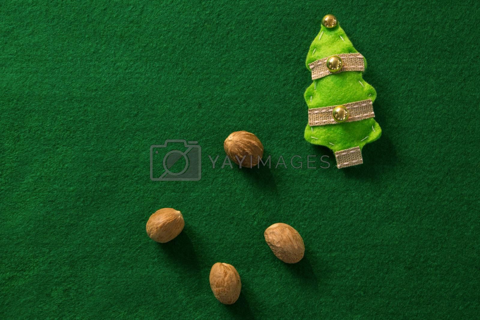 Overhead view of walnut with Christmas tree by Wavebreakmedia
