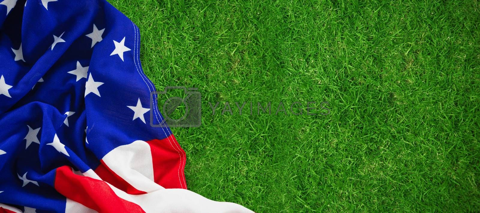 Close-up of American flag against closed up view of grass