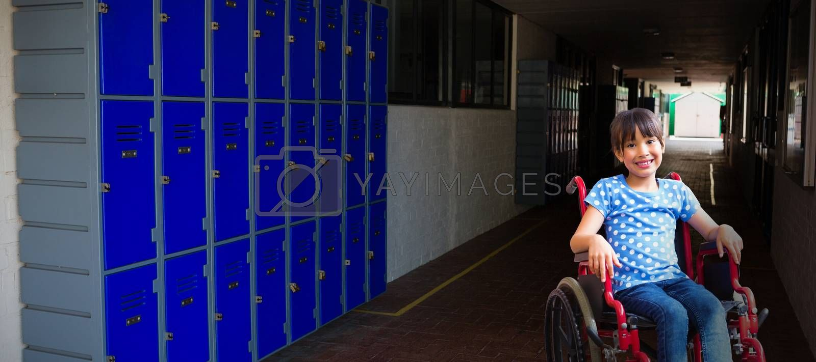 Composite image of cute disabled pupil smiling at camera in hall  by Wavebreakmedia