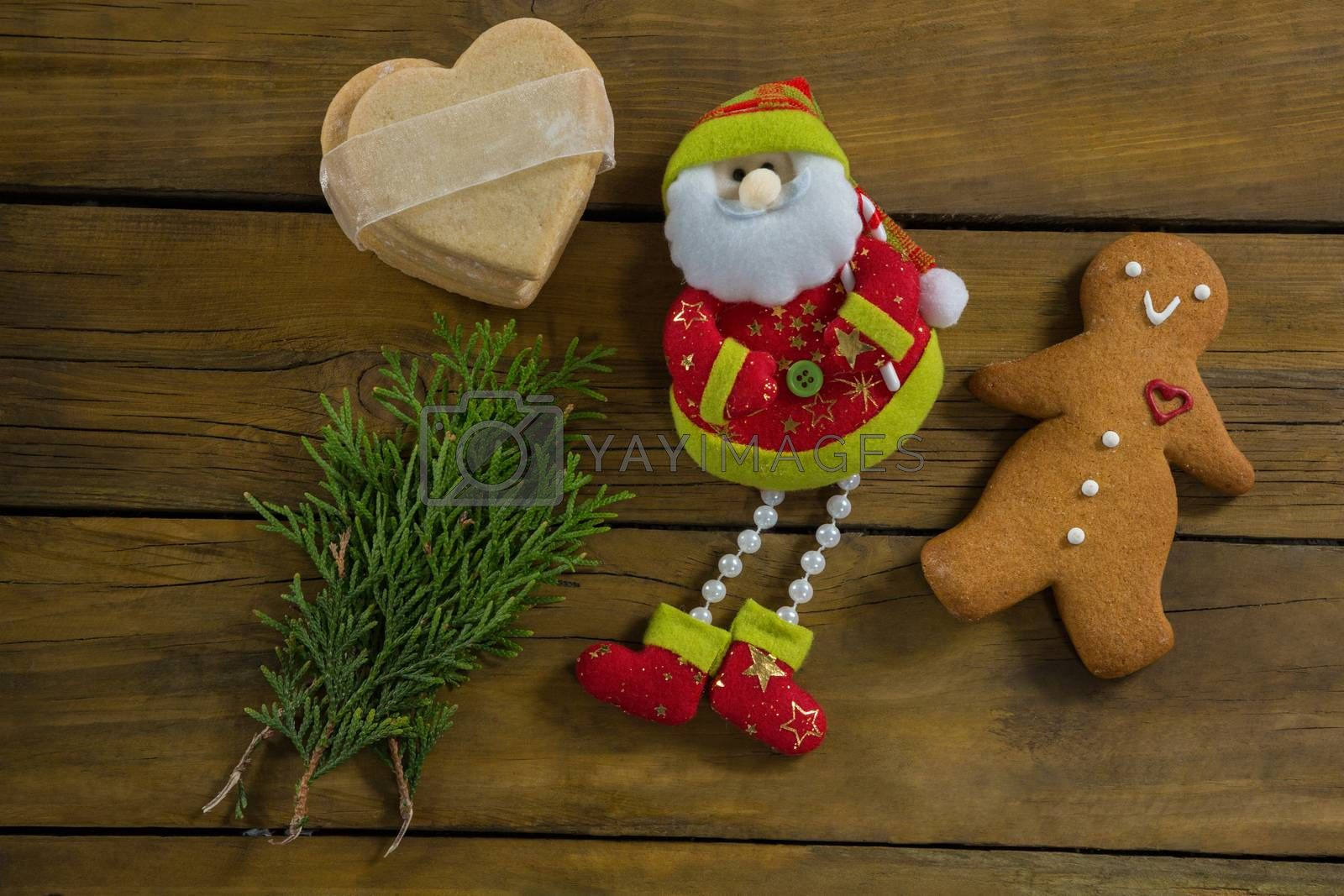 Overhead view of santa claus by twigs gingerbread man by Wavebreakmedia