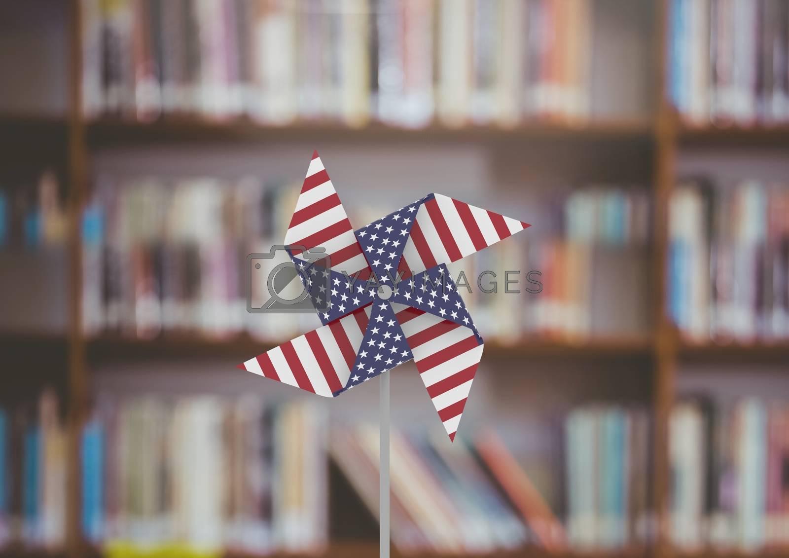 USA wind catcher in front of bookshelf by Wavebreakmedia