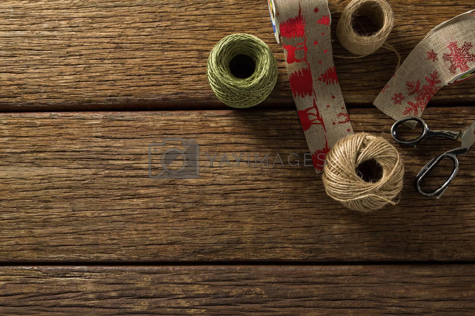 Thread and jute spools with scissor by Wavebreakmedia
