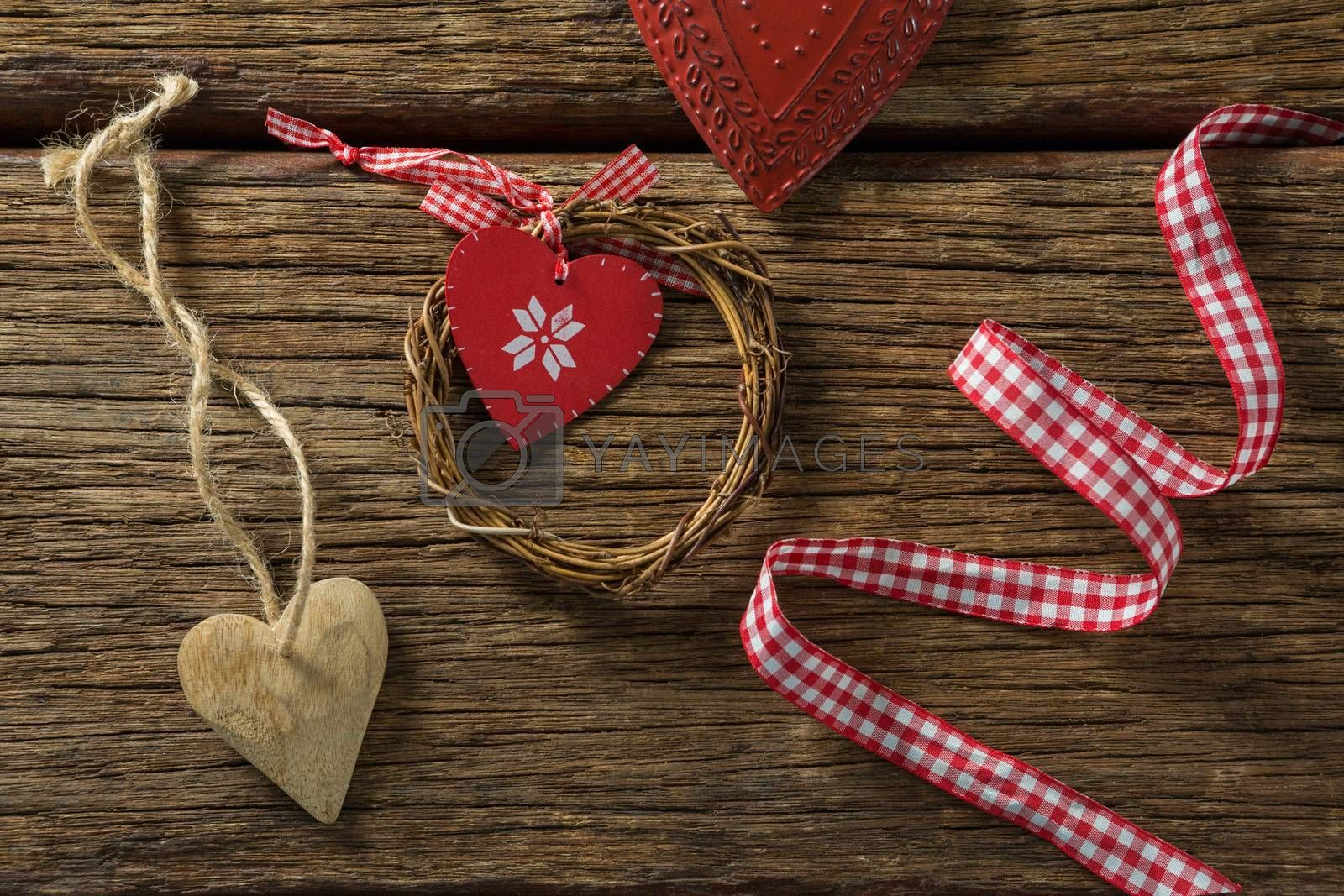 Overhead view of heart shape decoration with ribbon and wreath by Wavebreakmedia
