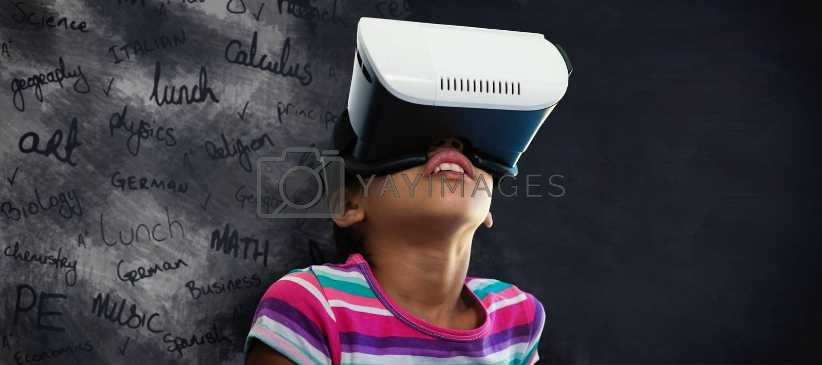 Composite image of close up of girl using virtual reality simulator by Wavebreakmedia