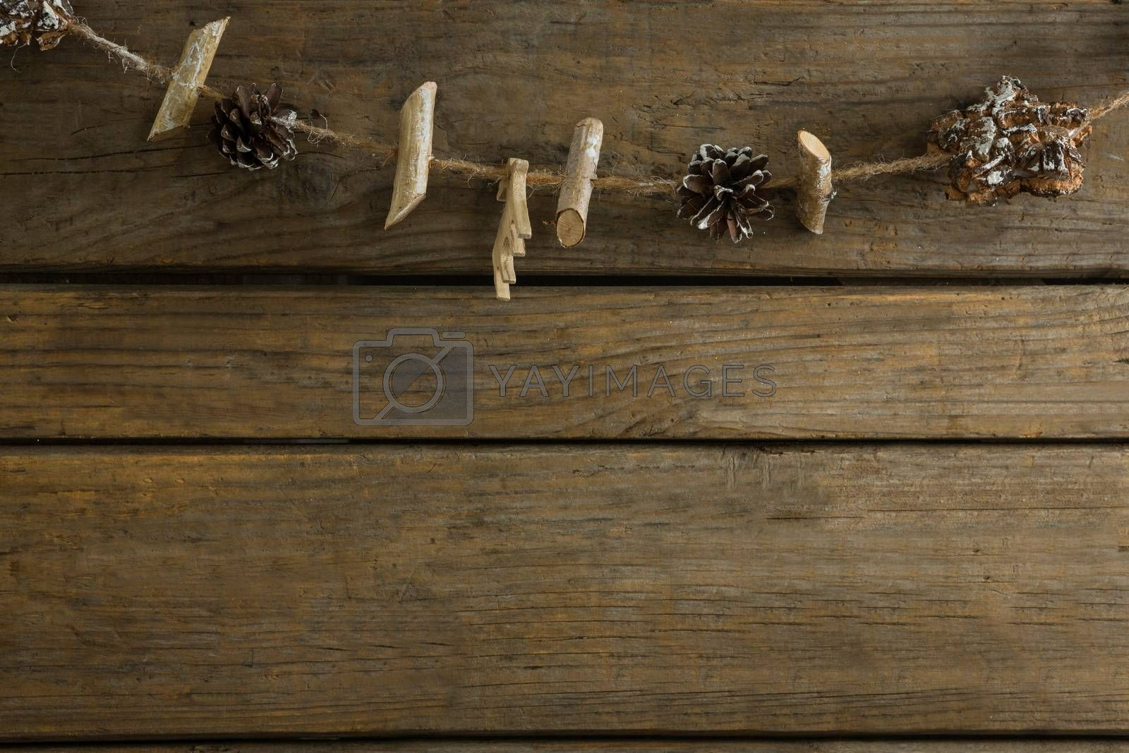 Overhead view pf sticks and pine cones with rope by Wavebreakmedia