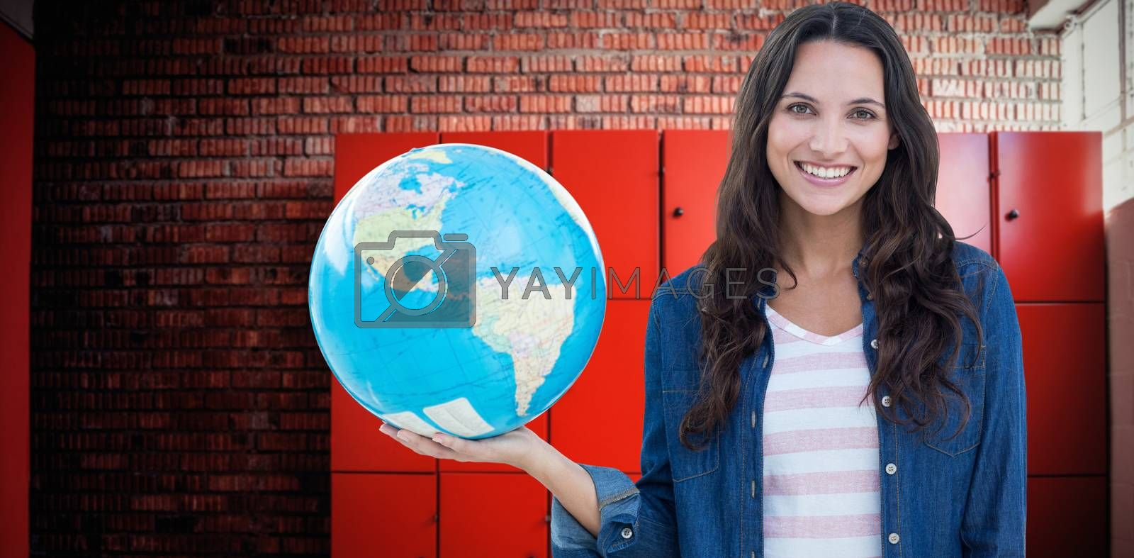 Composite image of happy woman with globe by Wavebreakmedia