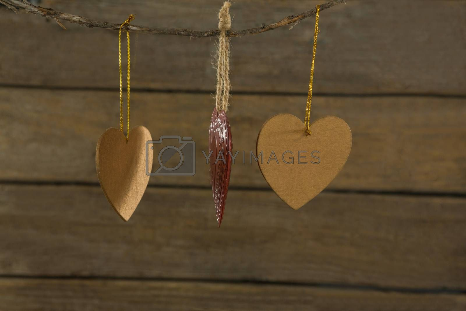 Close up of heart shape decoration hanging on rope by Wavebreakmedia