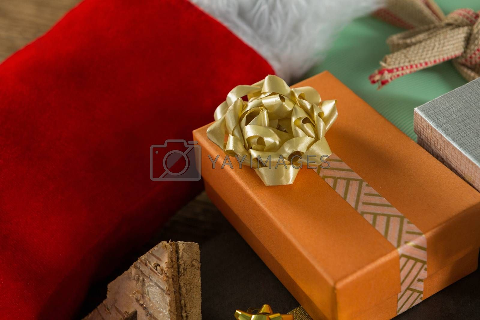 Close up of Christmas presents with stocking by Wavebreakmedia