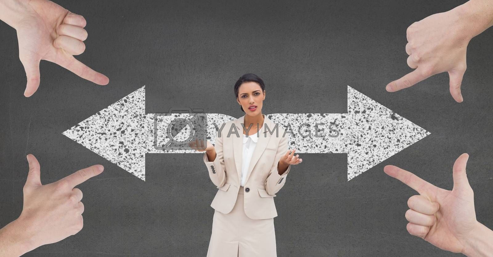 Hands pointing at confused business woman against grey background with arrows by Wavebreakmedia