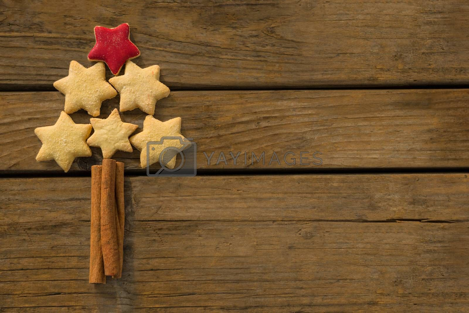 Close up of Christmas tree made with star shape cookies and cinnamon sticks by Wavebreakmedia