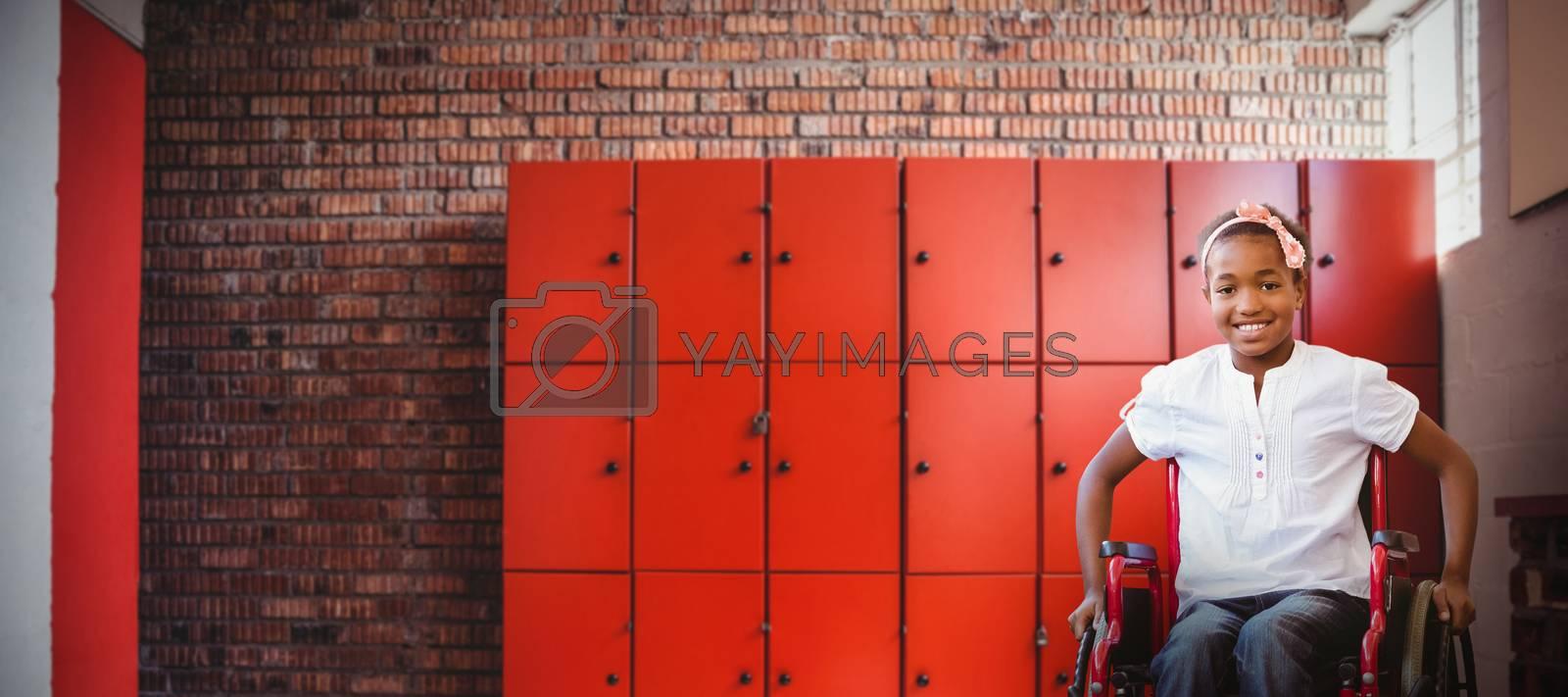 Composite image of girl sitting in wheelchair in school corridor by Wavebreakmedia