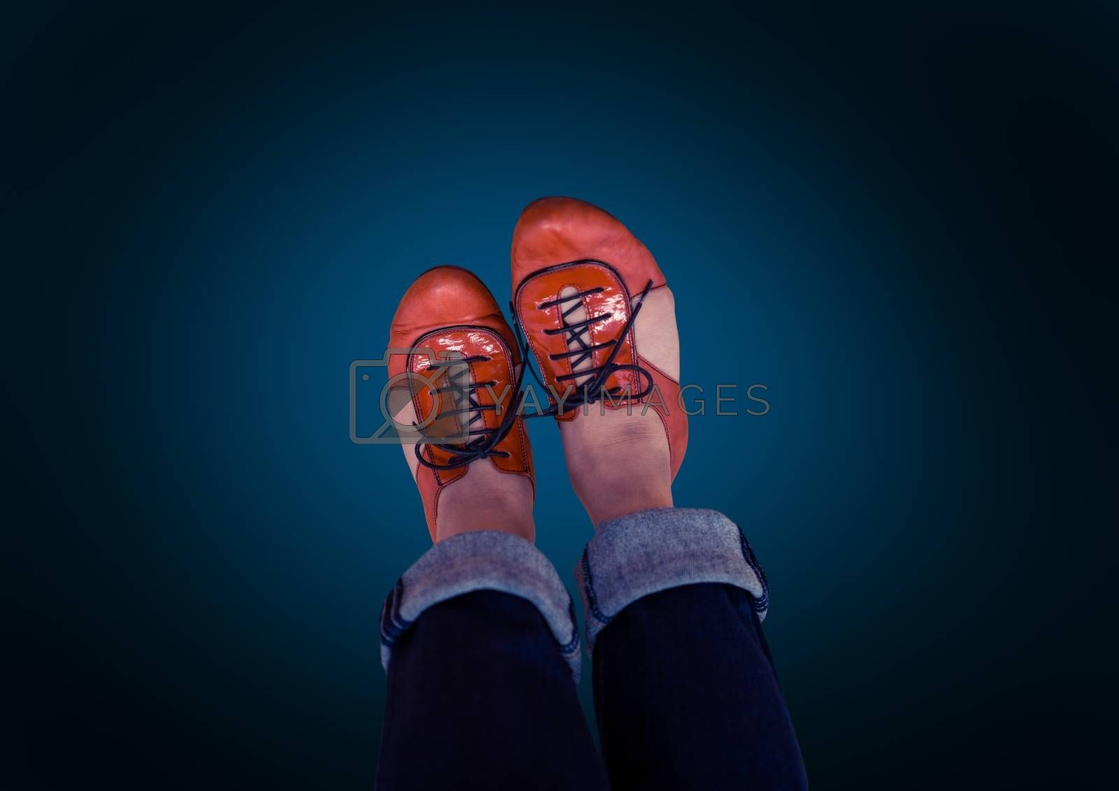 red shoes on feet with blue background by Wavebreakmedia