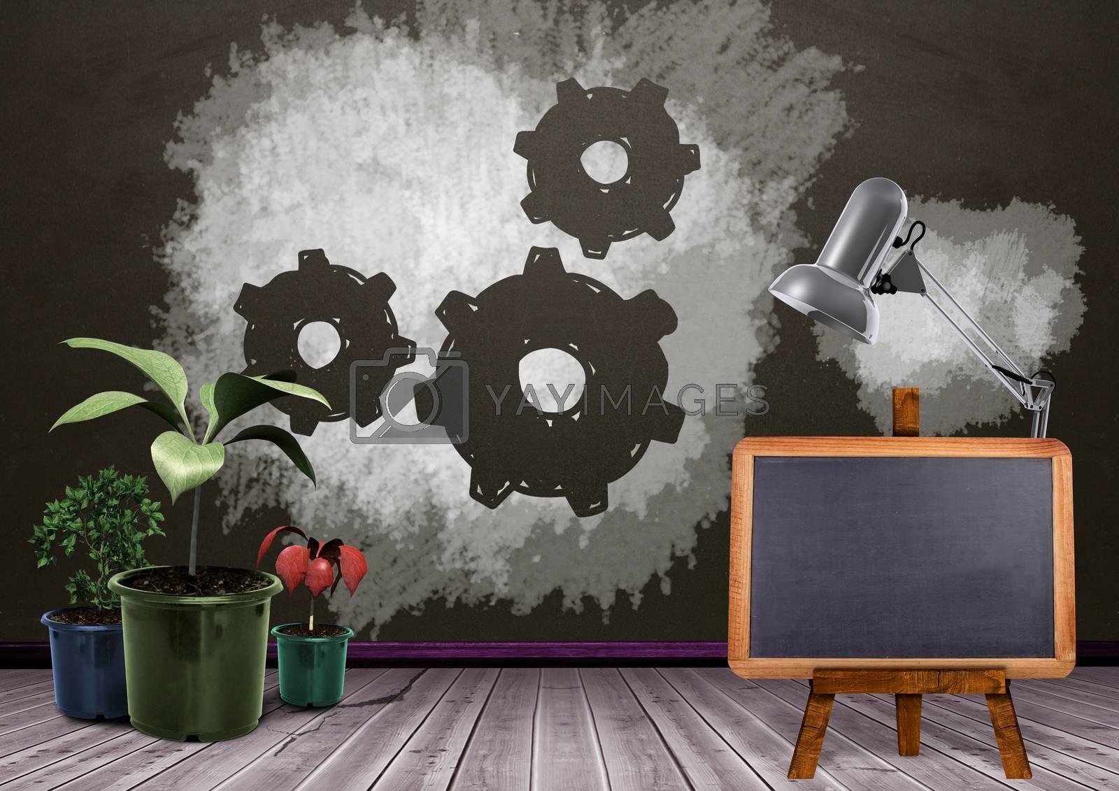 Blackboard and plants with setting cog gears on blackboard by Wavebreakmedia