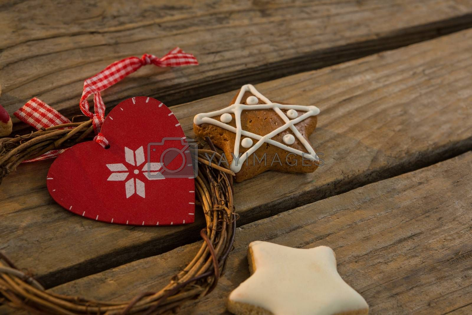 Close up of gingerbread cookies with Christmas decoration on table by Wavebreakmedia