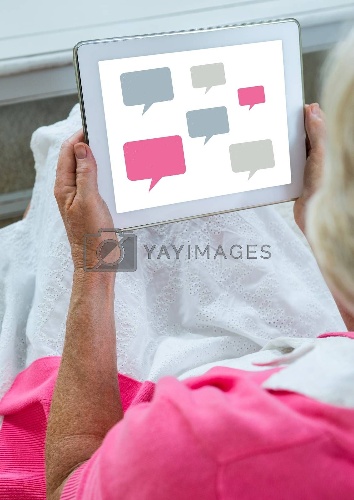 Chat icons on tablet in womans hand by Wavebreakmedia