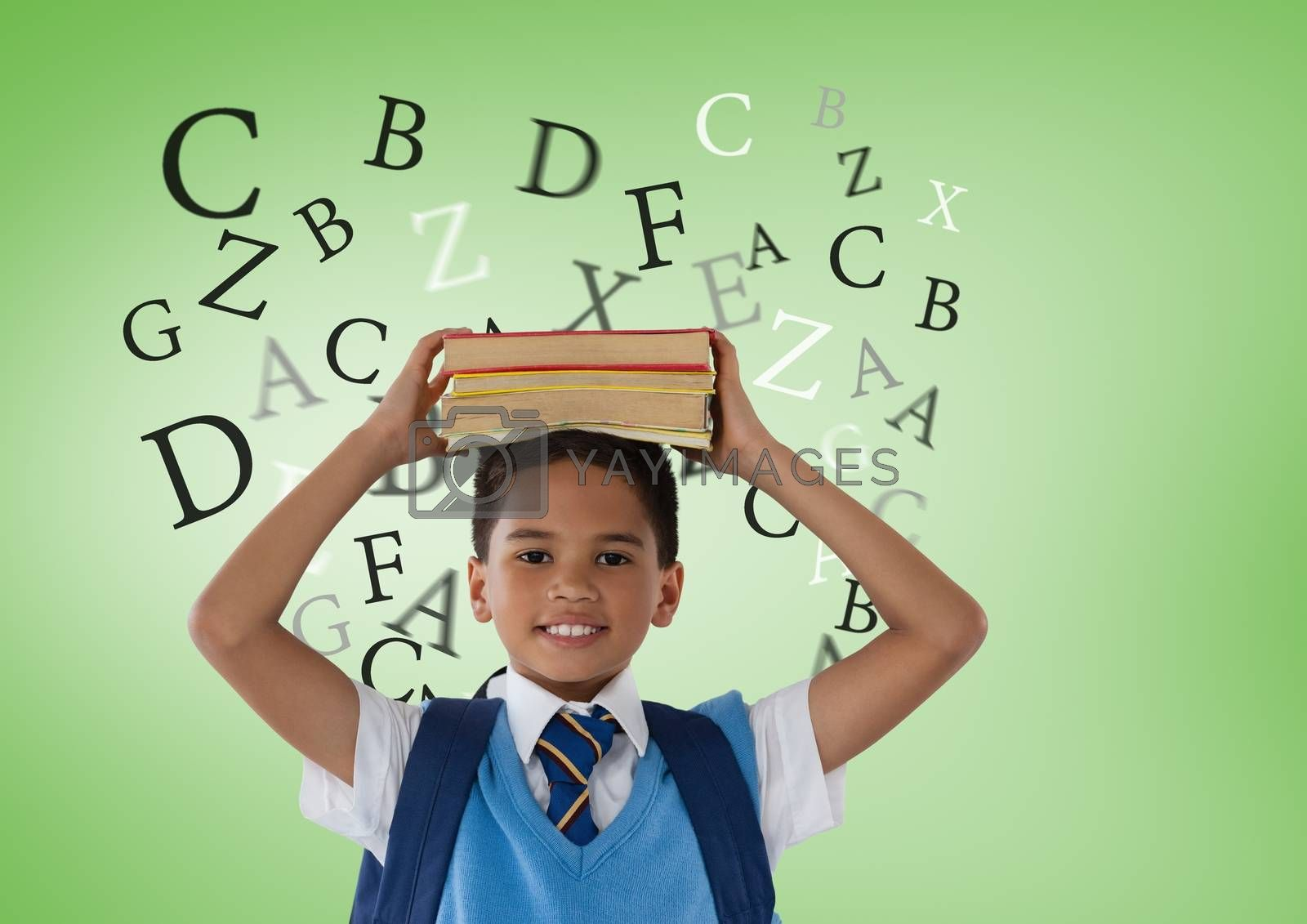 Many letters around Schoolboy holding books in front of green background by Wavebreakmedia