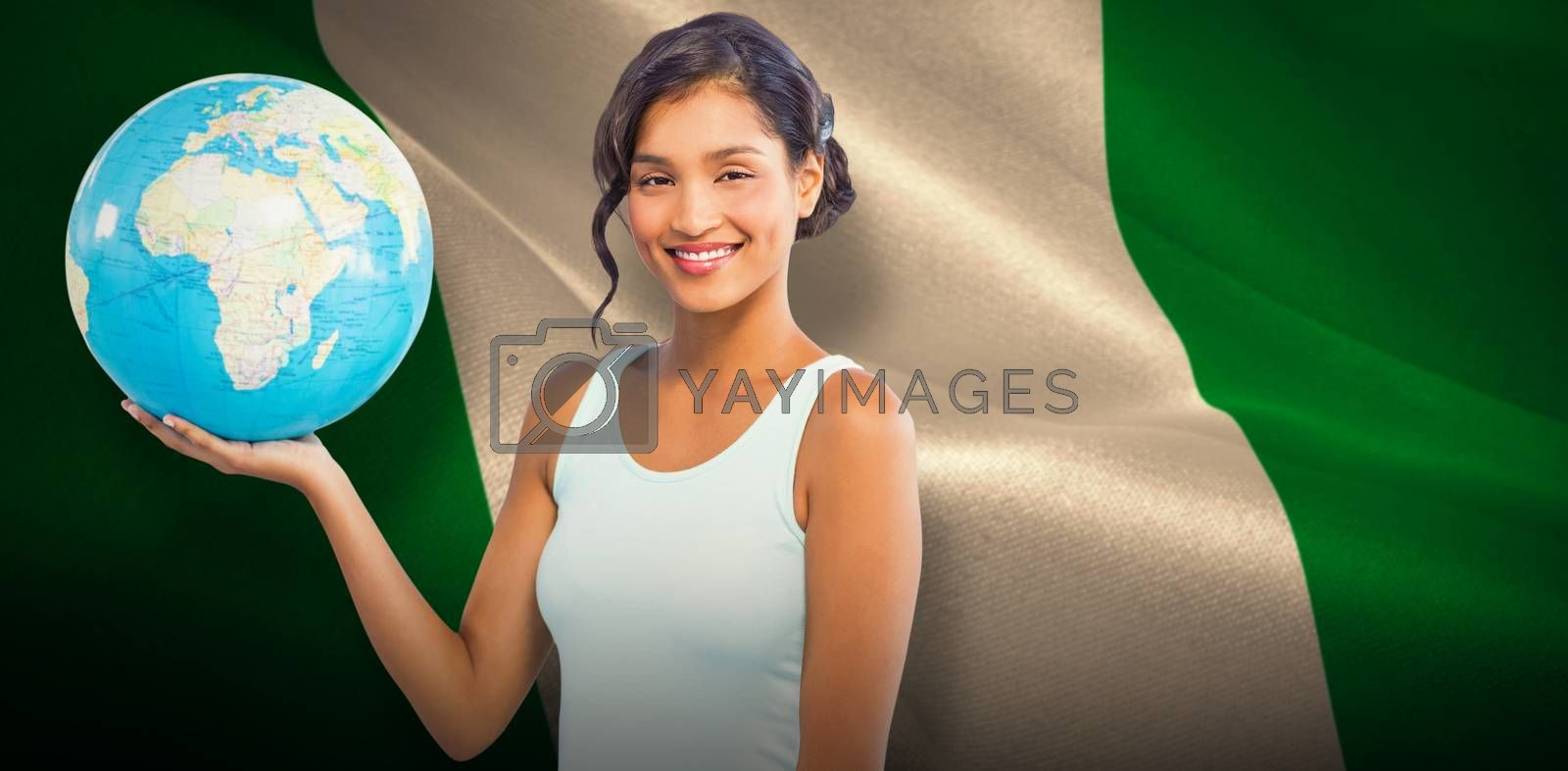 Composite image of pretty woman showing globe by Wavebreakmedia