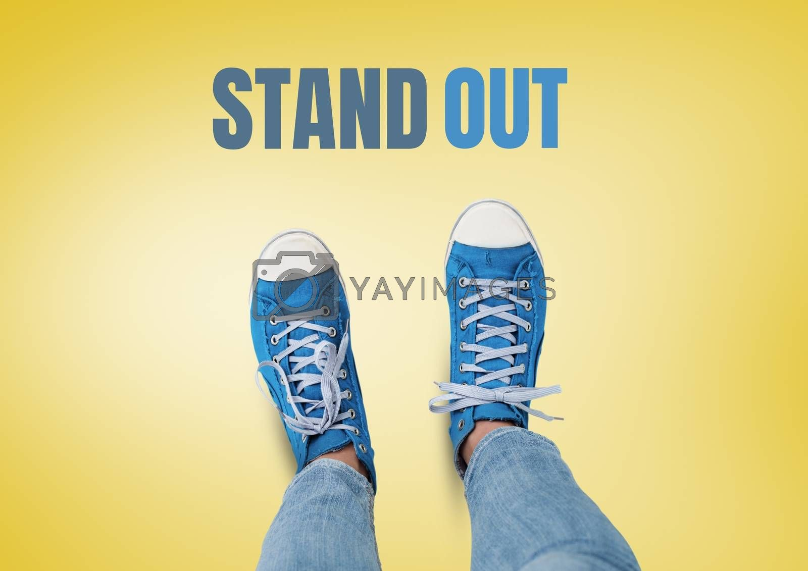 Stand out text and Blue shoes on feet with yellow background by Wavebreakmedia