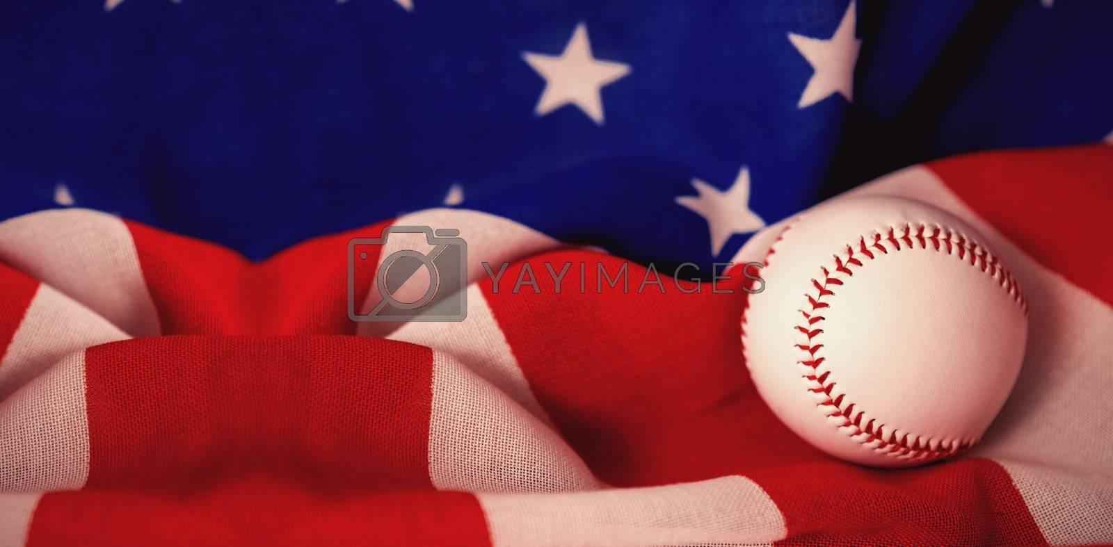Baseball ball on crumbled national flag by Wavebreakmedia