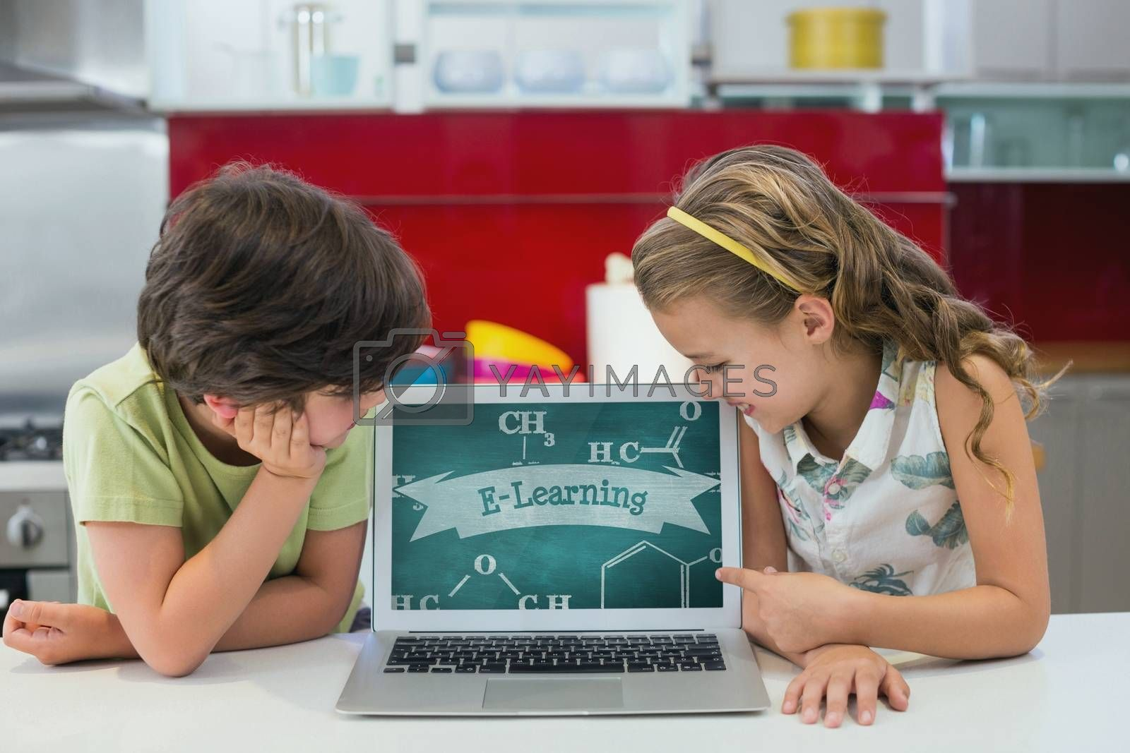 Kids looking at a computer with school icons on screen by Wavebreakmedia