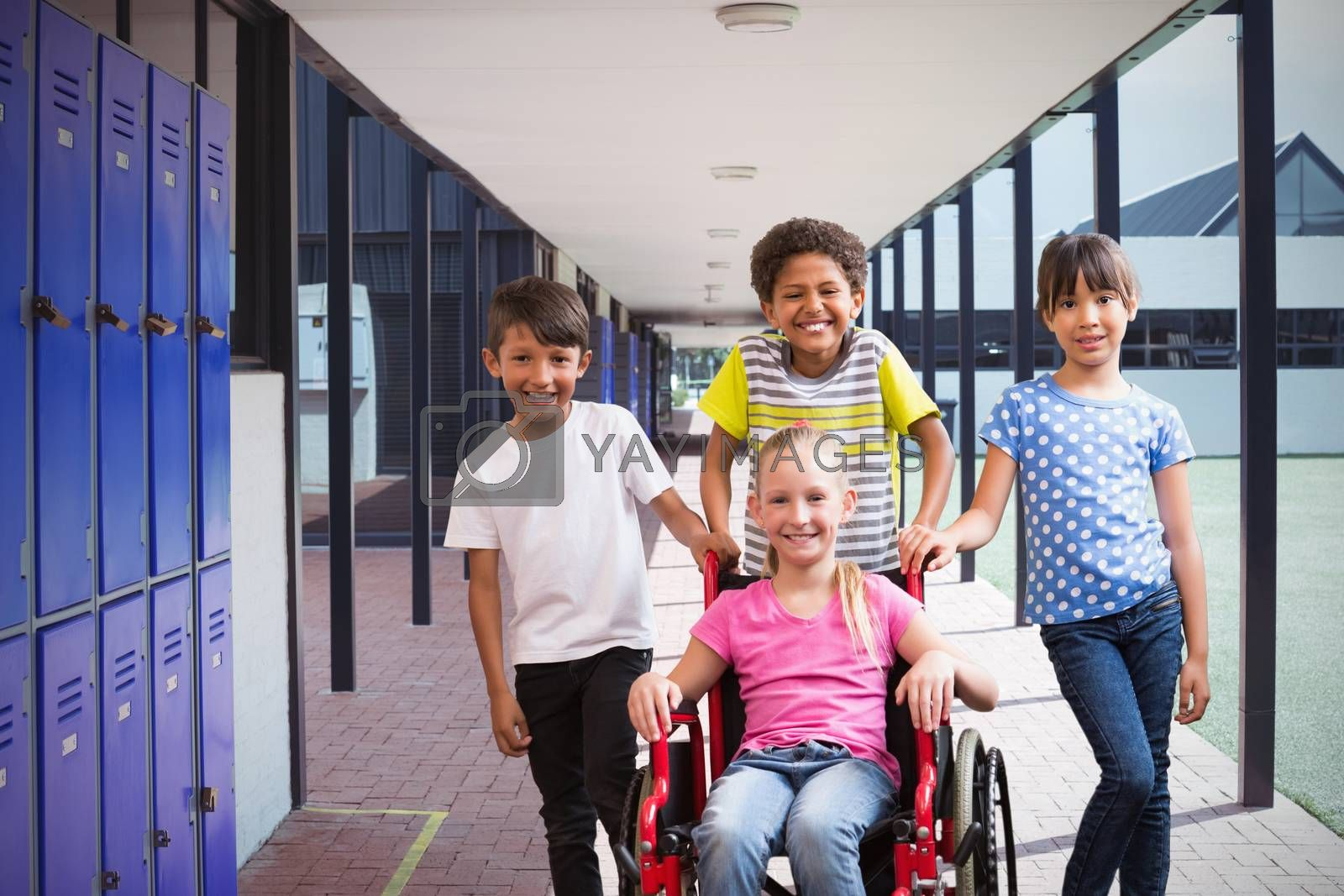 Composite image of cute disabled pupil smiling at camera with her friends by Wavebreakmedia