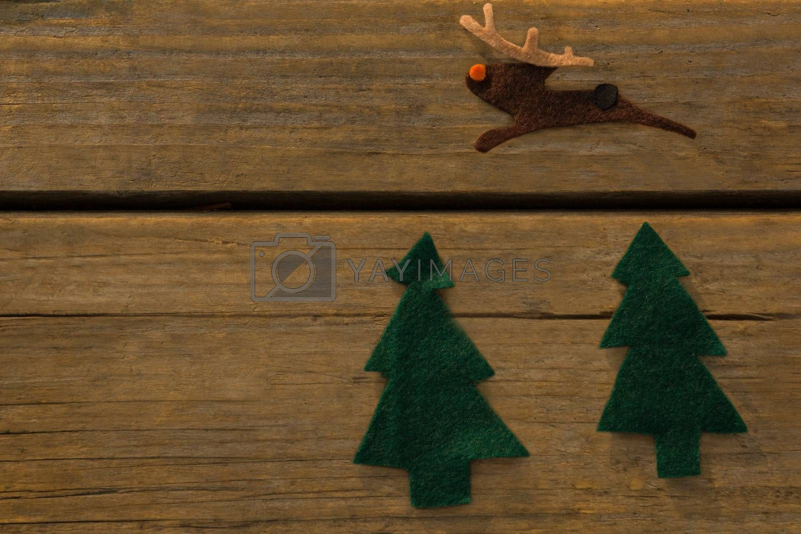 Overhead view of Christmas tree and reindeer decoration by Wavebreakmedia