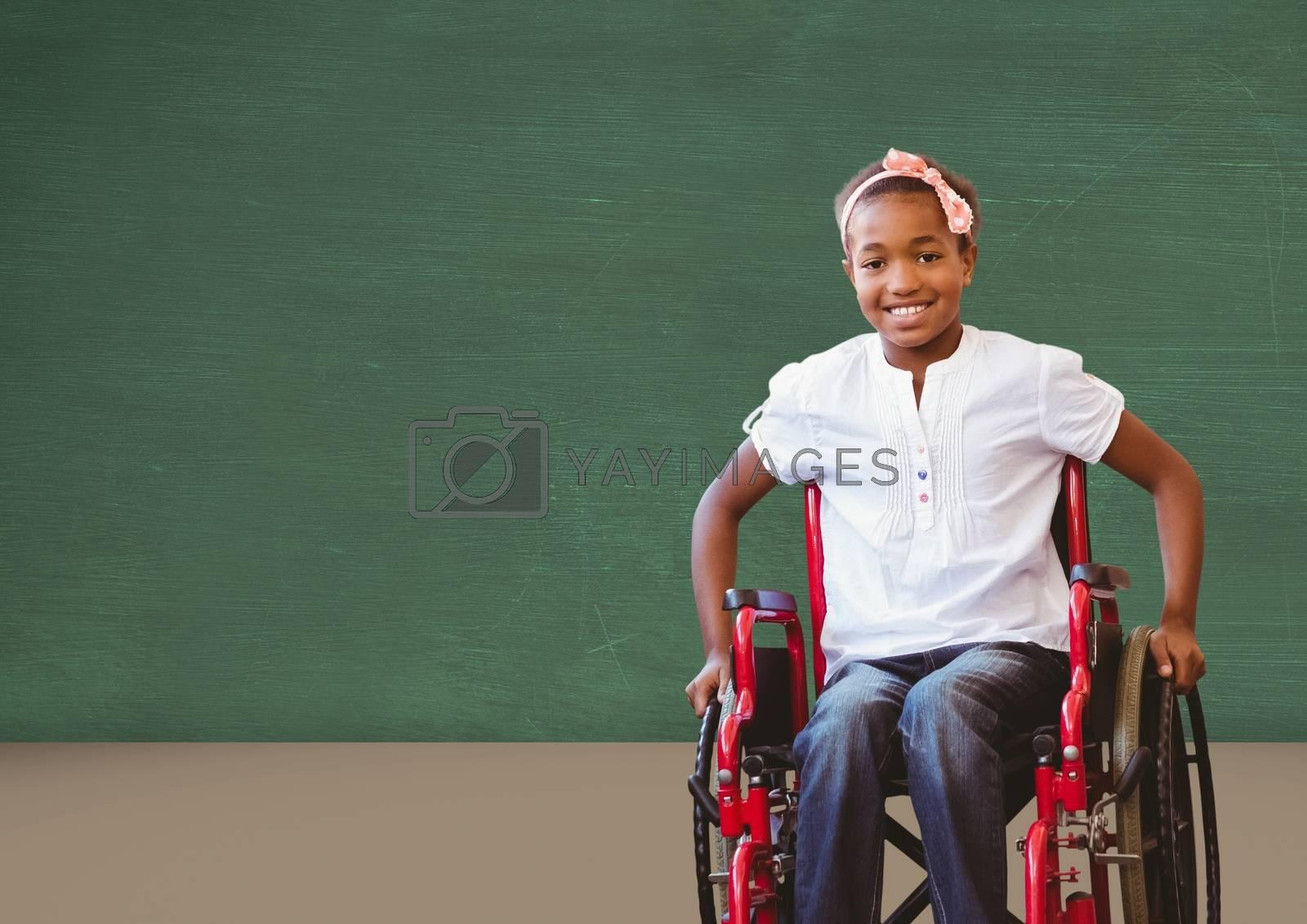 Disabled girl in wheelchair in front of blackboard by Wavebreakmedia