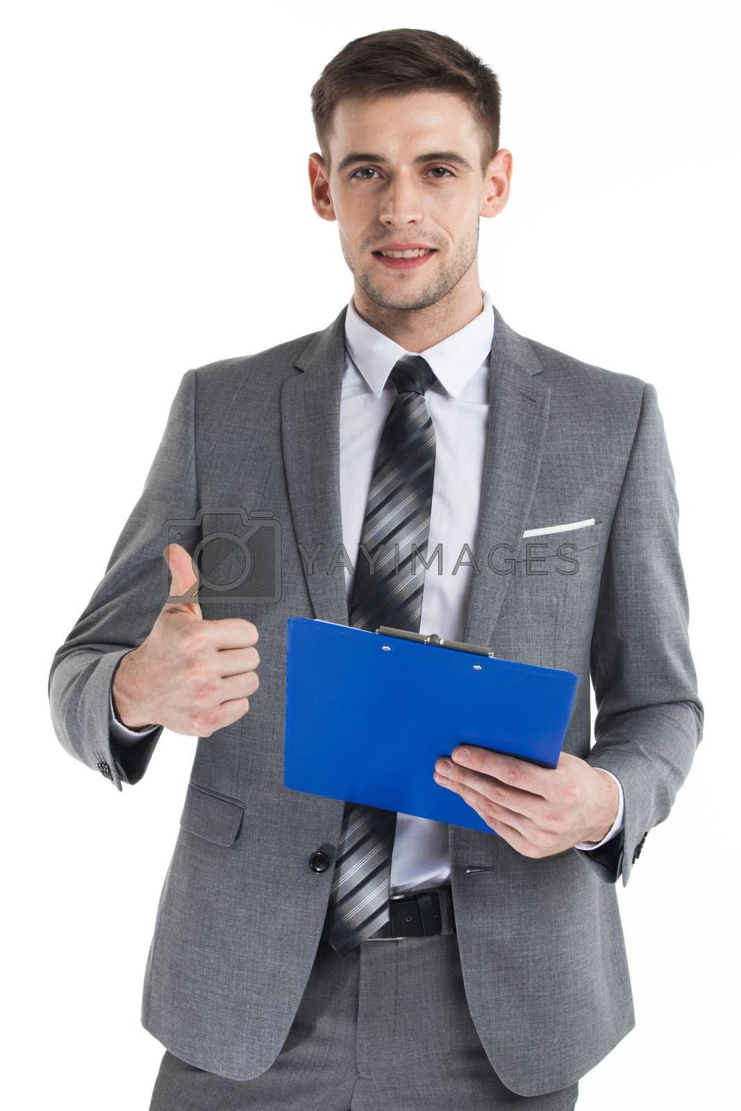 Happy businessman holding a fascicule with documents and giving thumb up isolated on white background