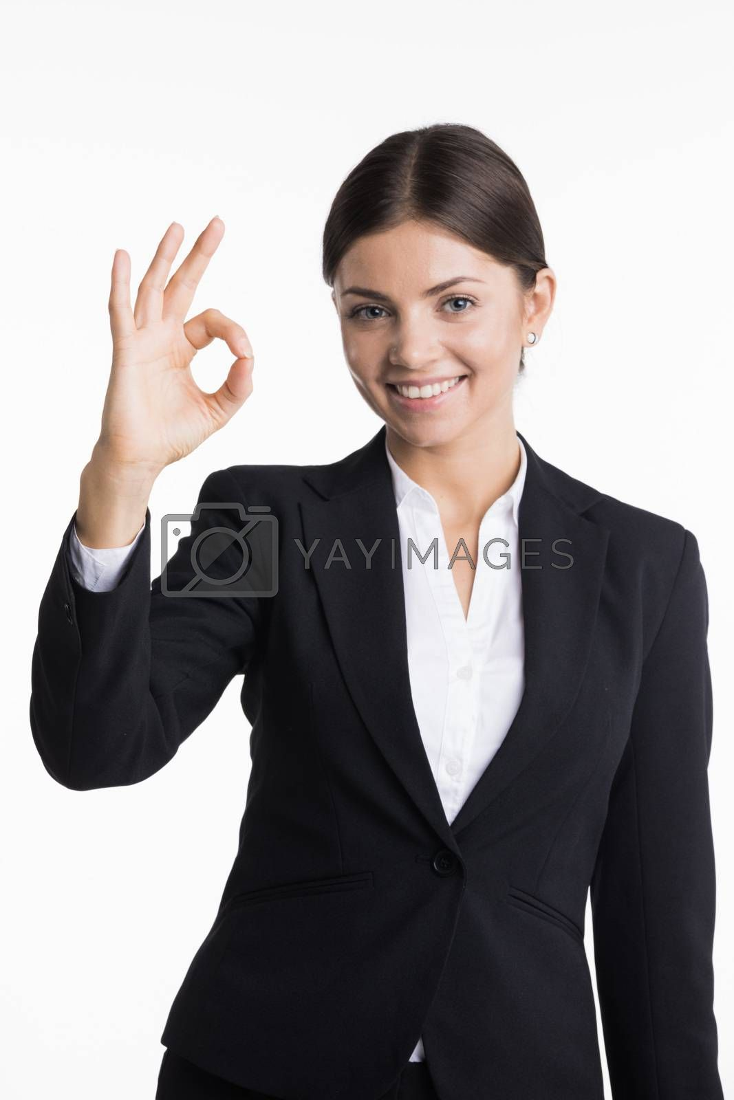 Businesswoman showing OK sign by Yellowj