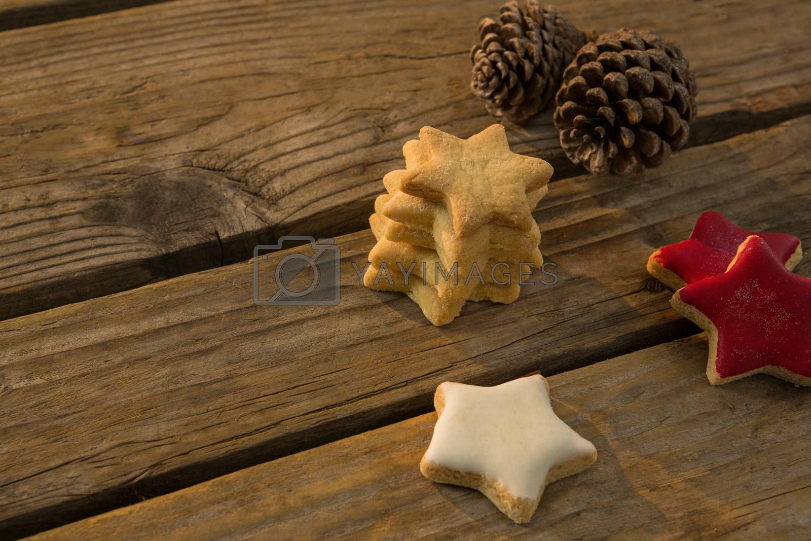 High angle view of star shaped cookies with pine cones on table by Wavebreakmedia