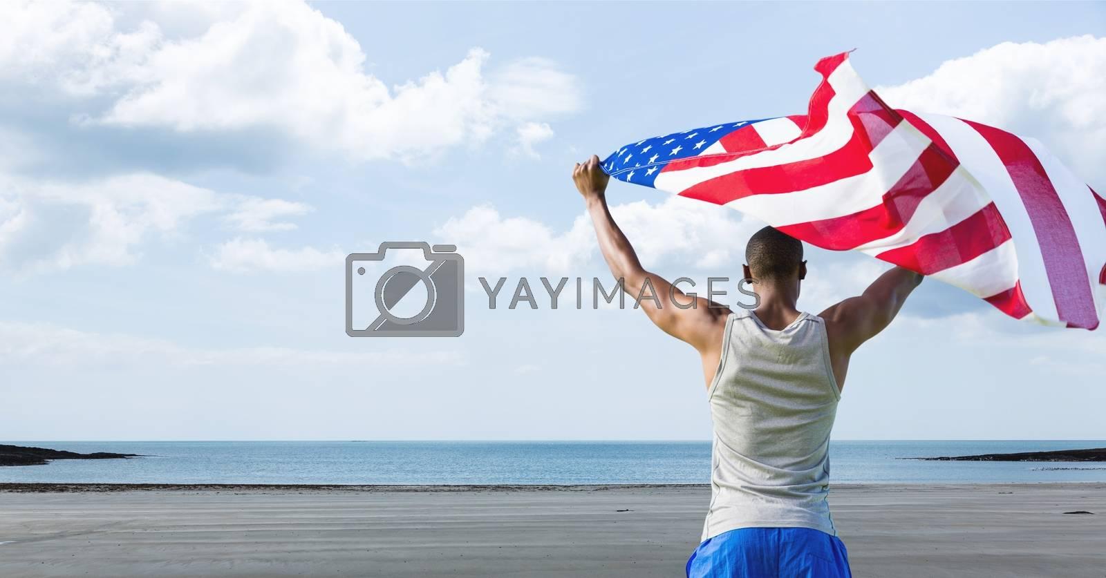 Man holding a USA flag in the beach by Wavebreakmedia