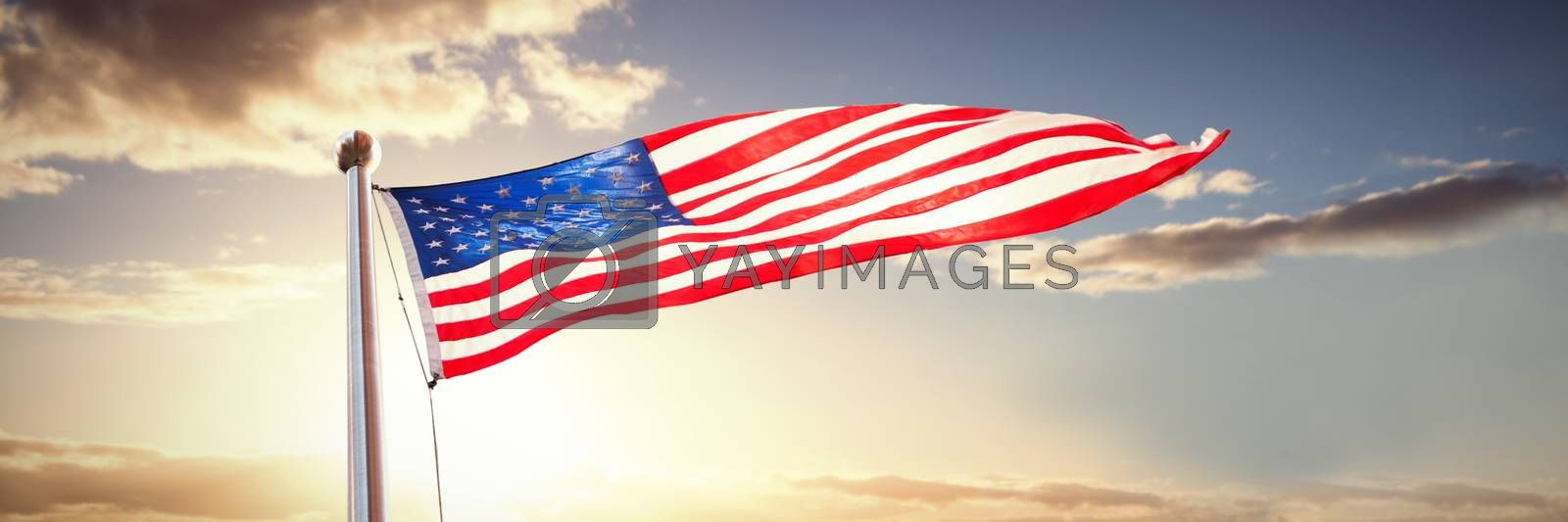Composite image of american flag waving over white background by Wavebreakmedia