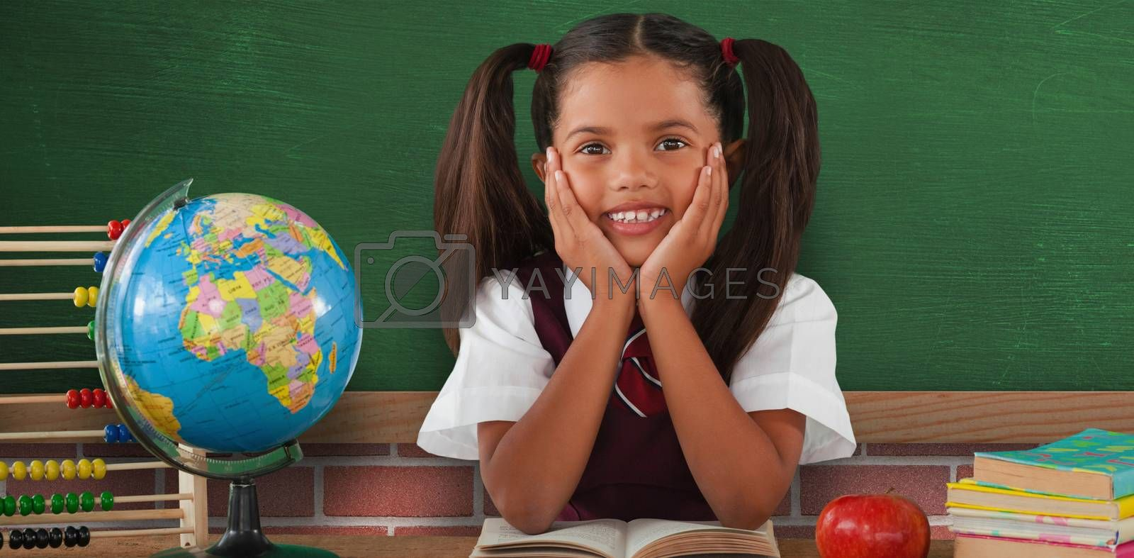 Composite image of schoolgirl leaning by globe and books by Wavebreakmedia
