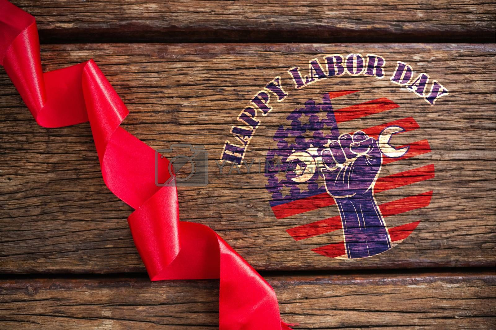 Composite image of happy labor day text over cropped hand holding tools by Wavebreakmedia