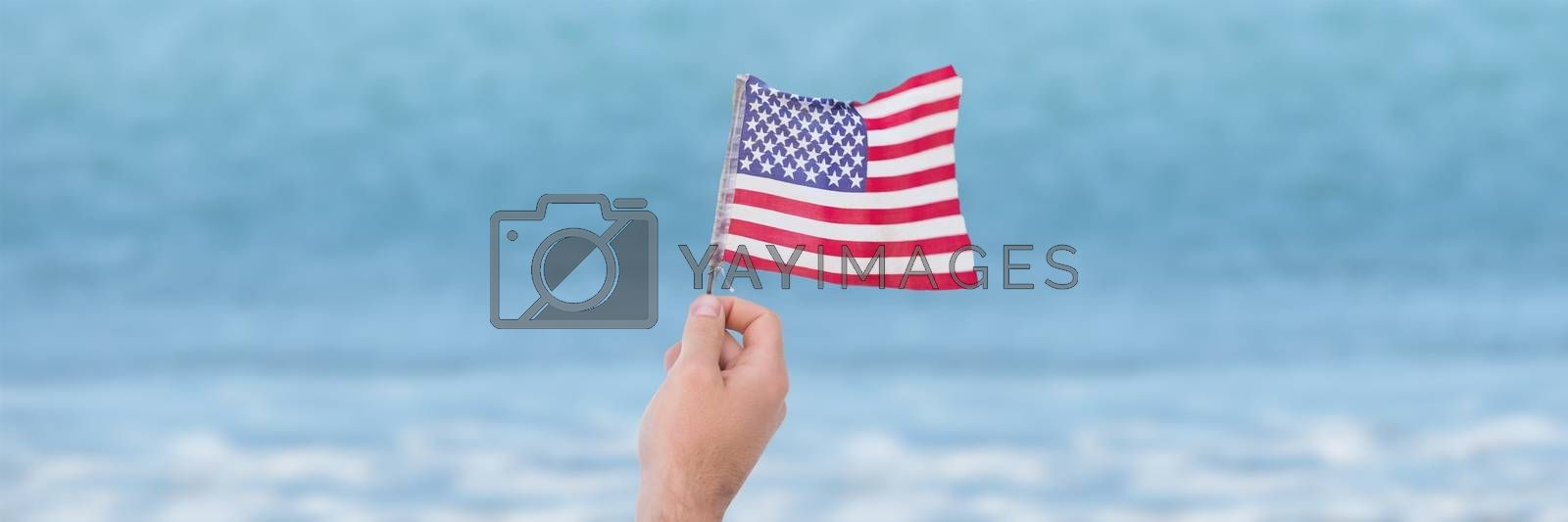 Person holding USA flag against sea background by Wavebreakmedia