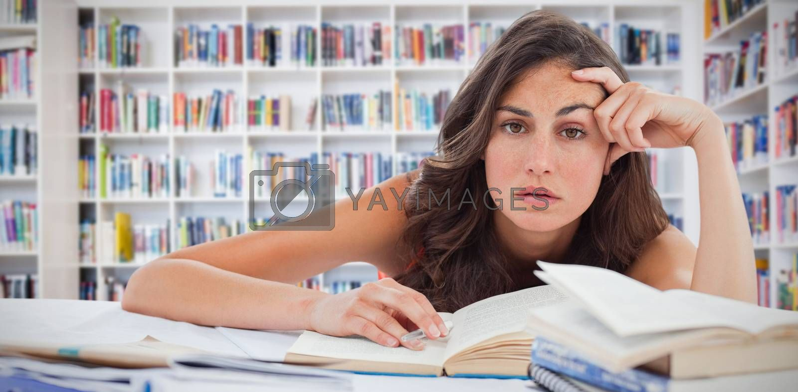 Composite image of bored student doing her homework by Wavebreakmedia