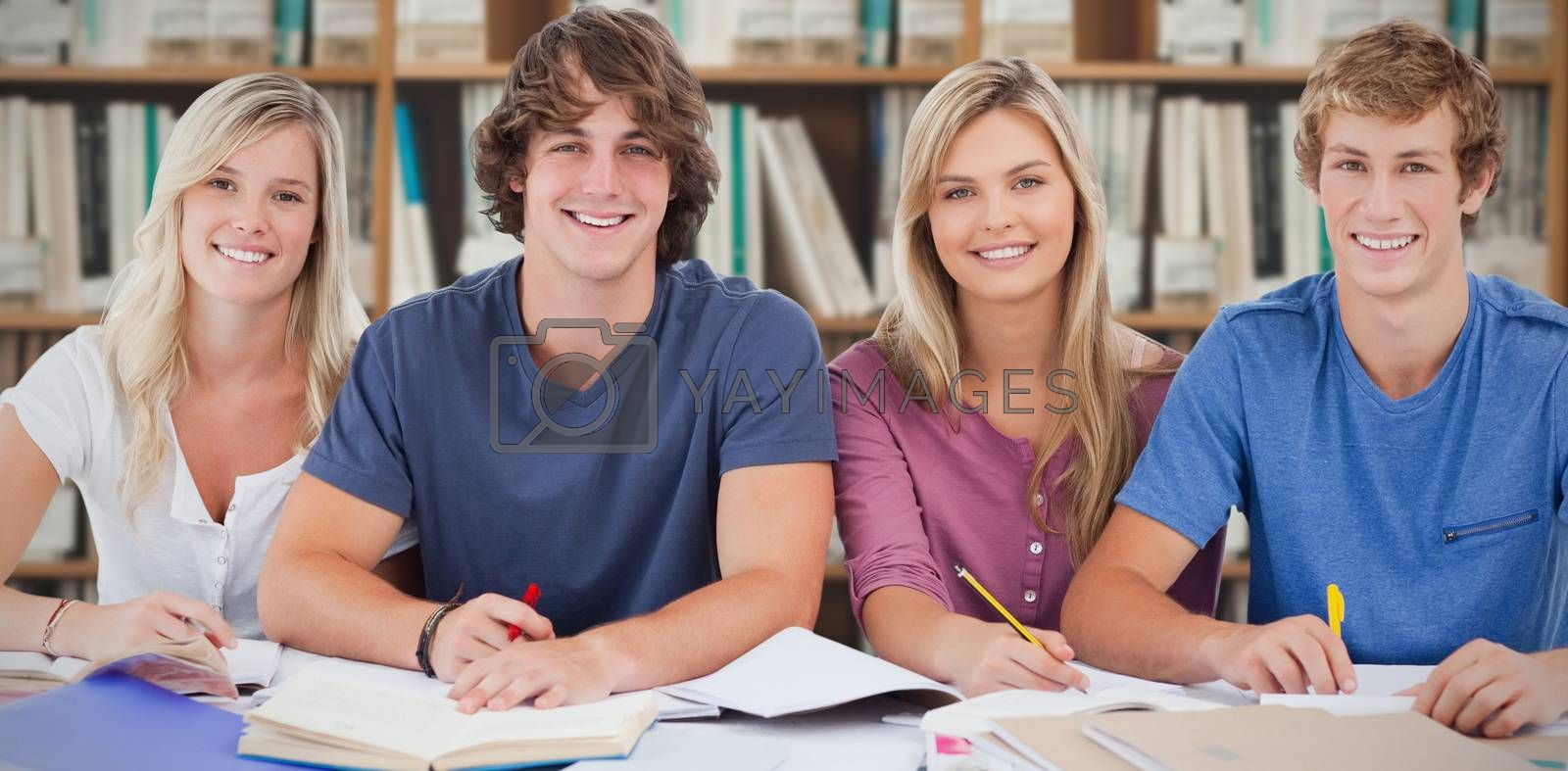 Composite image of four students looking at the camera by Wavebreakmedia
